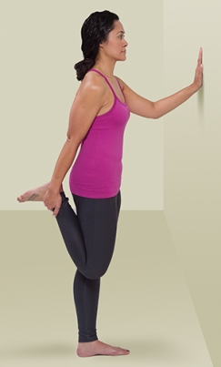 Person doing quad stretch exercise standing.